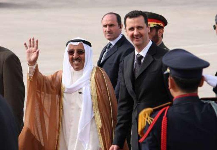 De Syrische president Assad ontvangt zijn gasten.