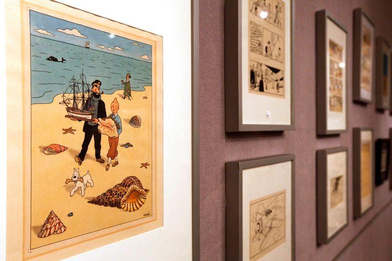 Originele Kuifje-tekeningen van Hergé tijdens een veiling in Parijs in 2010. Beeld Reuters
