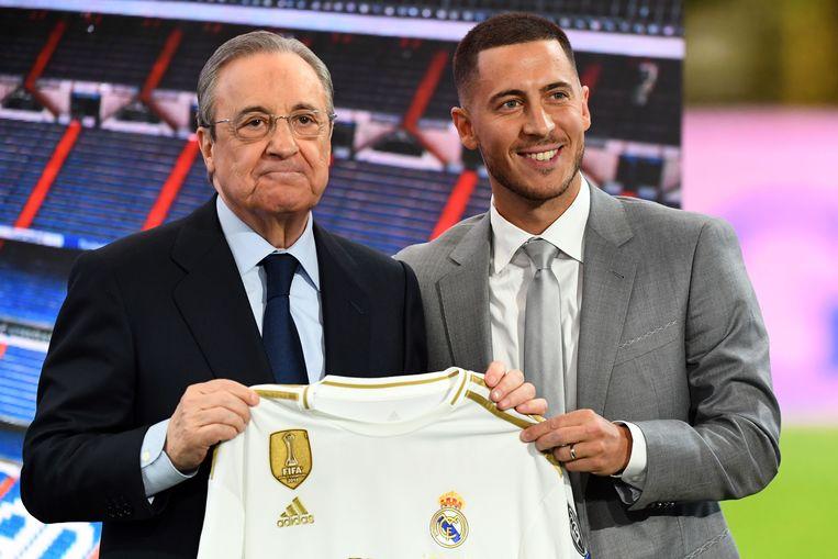 Eden Hazard naast voorzitter Florentino Pérez.