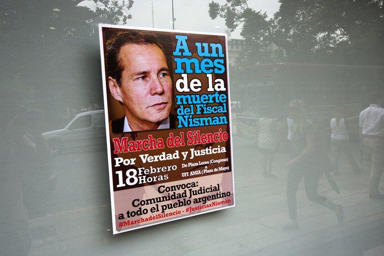 Een poster kondigt een protestmars aan voor gerechtigheid na de mysterieuze dood van aanklager Alberto Nisman Beeld ap