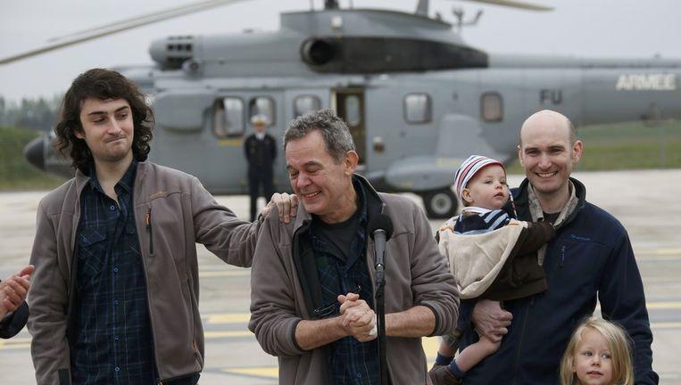 Edouard Elias, Didier François en Nicolas Henin bij aankomst op het vliegveld. Beeld reuters