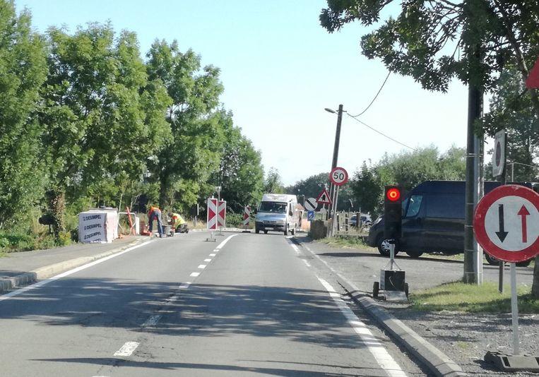 Verkeerslichten op de Vollezelestraat omdat een aannemer een muur moet plaatsen