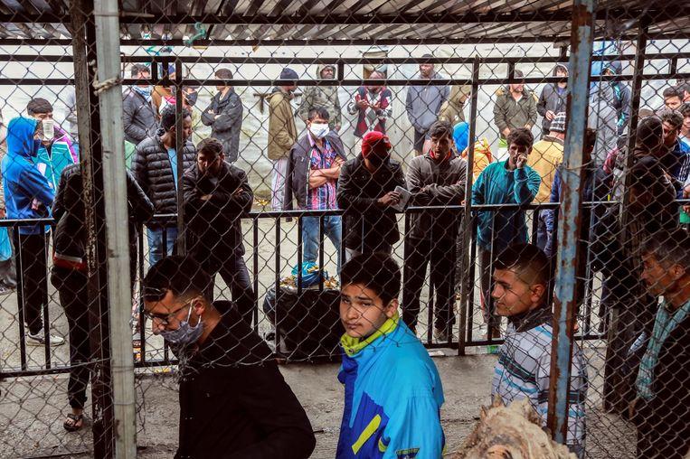 Migranten en vluchtelingen in kamp Moria. Beeld Hollandse Hoogte / AFP