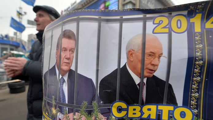 Viktor Ianoukovitch, le président ukrainien (G), et Mikola Azarov, son Premier ministre, sont honnis par les manifestants ukrainiens pro-européens.
