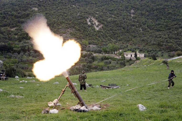 Beelden van de strijd om de Al Ghab-vlakte waar Syrische oppositiegroepen in 2015 tegen regeringstroepen van Assad vochten.  Beeld REUTERS