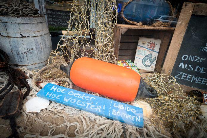 Een andere slogan van de Arnhemse Visbroertjes: 'Hoe oester, hoe woester'.