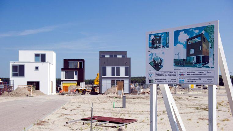 Een nieuwbouwproject in Almere Poort. In de provincie Flevoland stegen de huren van vrijesectorwoningen het afgelopen kwartaal het hardst van heel Nederland (plus 23 procent). Beeld anp
