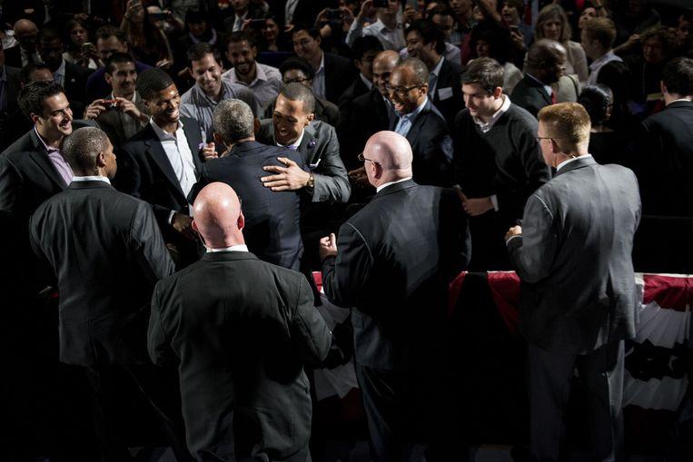 President Obama wordt omringd door agenten van de Secret Service tijdens een bijeenkomst op Northwestern University. Het team dat de president beveiligt, wordt de 'elite van de elite' genoemd binnen de Secret Service. Beeld AFP