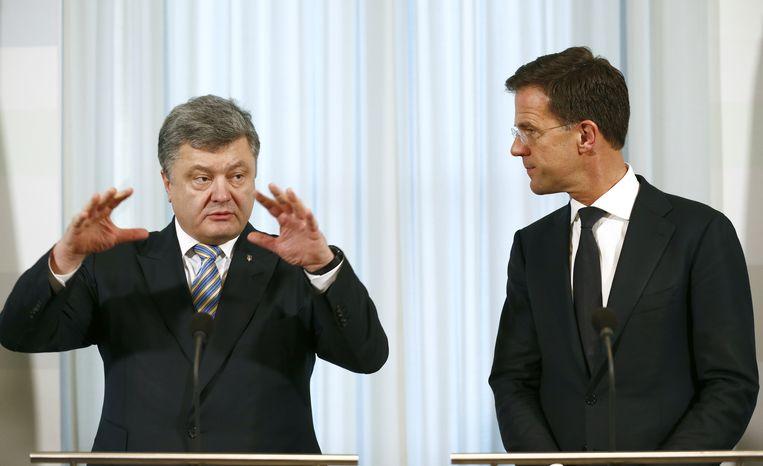Minister president Mark Rutte en de Oekraïense president Petro Poroshenko tijdens een persconferentie, afgelopen november. Porosjenko brengt een tweedaags bezoek aan Nederland. Het is de eerste keer sinds zijn aantreden in 2014 hij Nederland bezoekt. Beeld anp