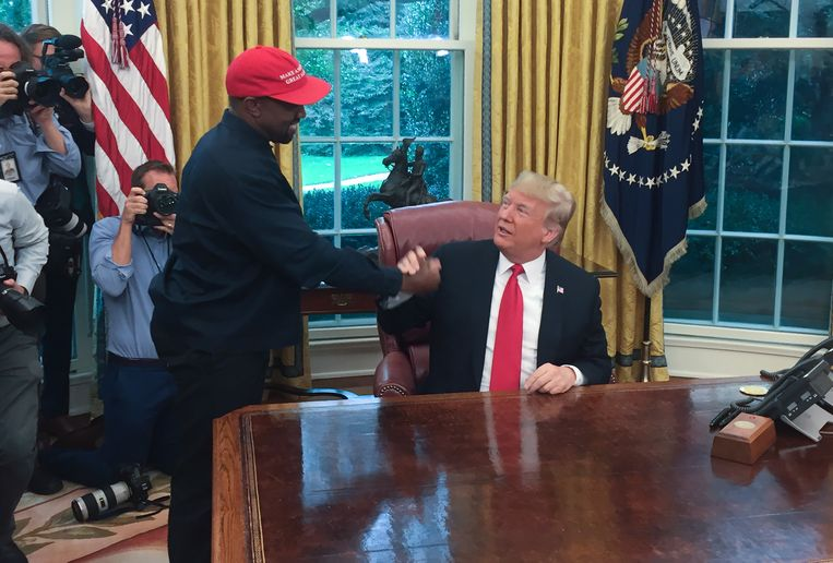 West op bezoek bij Trump in het Oval Office in 2018. Beeld AFP