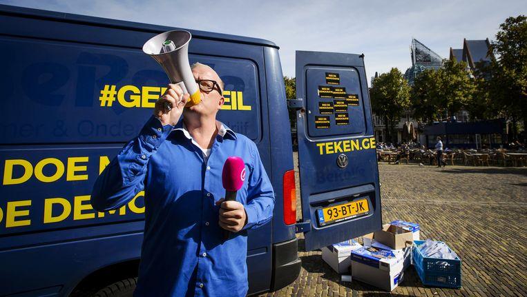 Presentator Jan Roos voor een 'Geenpeilauto' Beeld ANP