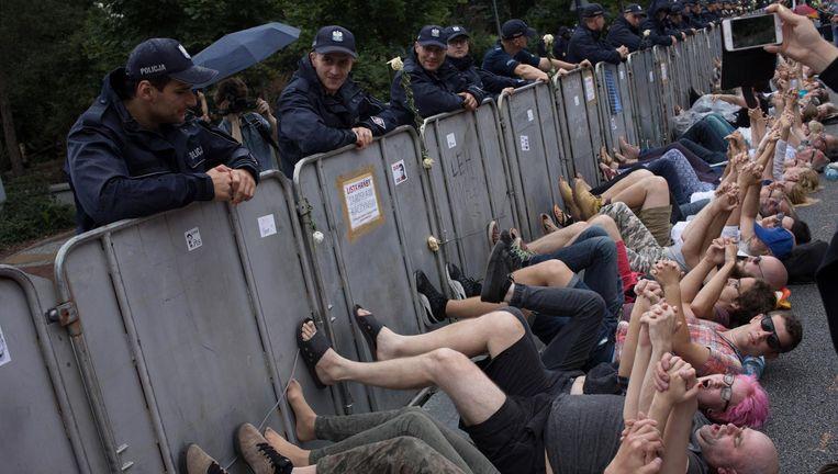 Polen protesteren tegen plannen van de overheid om de benoeming van opperrechters te wijzigen. Beeld Piotr Malecki/Napo Images
