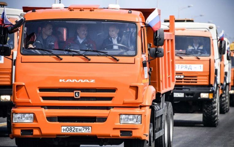 Poetin in de vrachtwagen. Beeld AFP