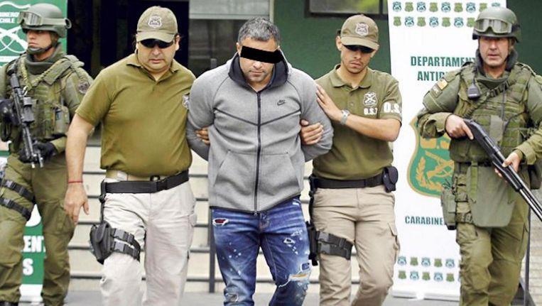 Rico de Chileen' wordt in oktober 2017 in Chili opgepakt in de garage van een hotel waar hij verbleef met zijn Colombiaanse vriendin Beeld ANP