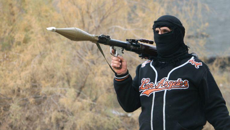 Een strijder van de ISIS in de Irakese stad Fallujah Beeld ap