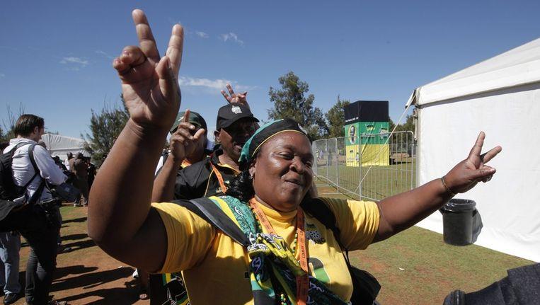ANC-aanhangers zingen en dansen, voorafgaand aan het 53ste nationale partijcongres in Mangaung, Zuid-Afrika Beeld EPA