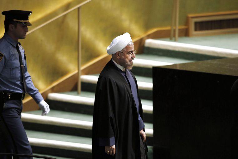 Rouhani loopt naar het spreekgestoelte. Beeld ap
