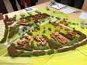Maquette van het plan voor De Hes tussen Arnhem en Renkum zoals gepresenteerd aan de omwonenden met linksboven de woontoren met ontmoetingscentrum.