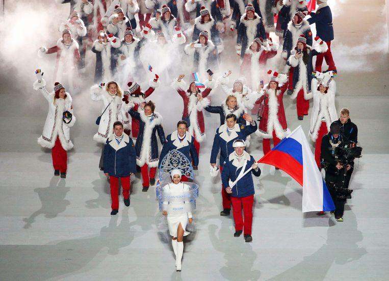 De Russische ploeg in 2014 tijdens de openingsceremonie van de Olympische Spelen in Sotsji. Beeld EPA