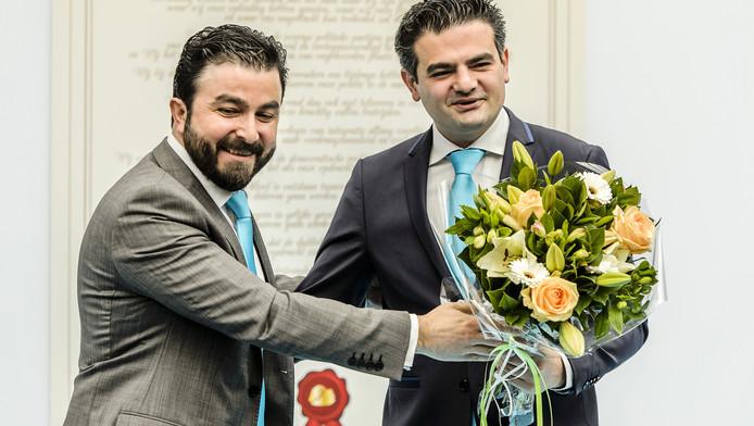 Partijvoorzitter Selcuk Ozturk (L) en lijsttrekker Tunahan Kuzu tijdens de opening van het partijbureau van de politieke beweging Denk.