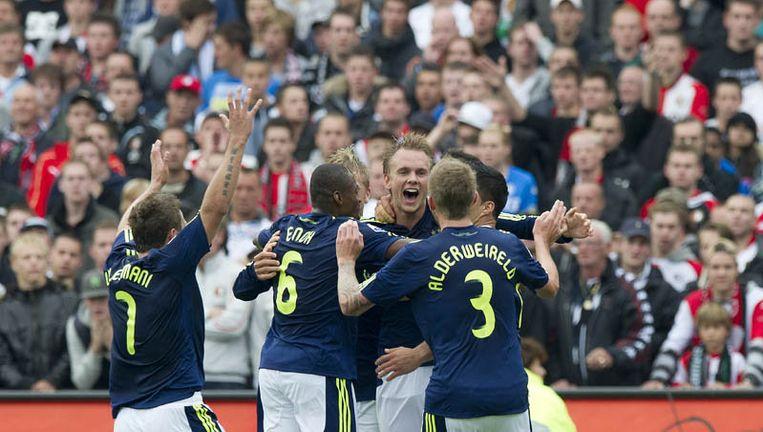 De spelers van Ajax vieren het doelpunt Siem de Jong (M) in de wedstrijd tegen Feyenoord (0-1). Foto ANP Beeld