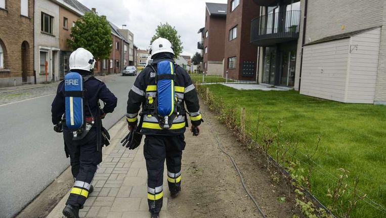 Belgische brandweermannen in Wetteren. Beeld afp