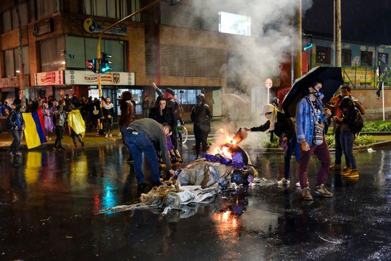 In Bogotá raakten zeker 37 politiemensen en 42 burgers gewond. Beeld Getty Images