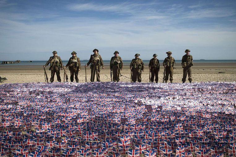 Een herdenking op Gold beach, vorig jaar. Beeld AFP