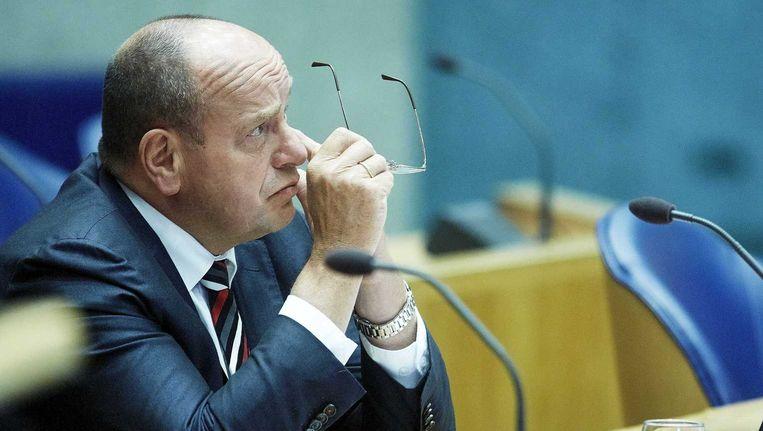 Fred Teeven tijdens het debat over de stijging van het aantal asielzoekers. Beeld anp
