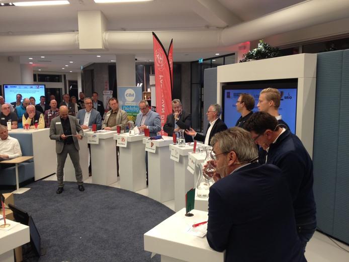 De negen lijsttrekkers tijdens het verkiezingsdebat van ondernemers.