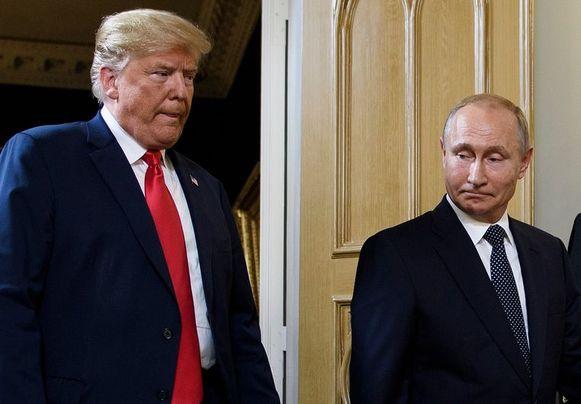De Amerikaanse president Trump (links) en zijn Russische ambtsgenoot Vladimir Poetin in Helsinki eerder dit jaar.