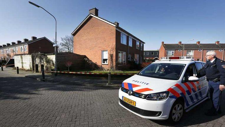 Politie bij het huis van het vermoorde echtpaar. Beeld anp