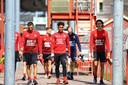 Giorgi Aburjania, Godfried Roemeratoe en Ramiz Zerrouki lopen naar het veld voor hun eerste training.