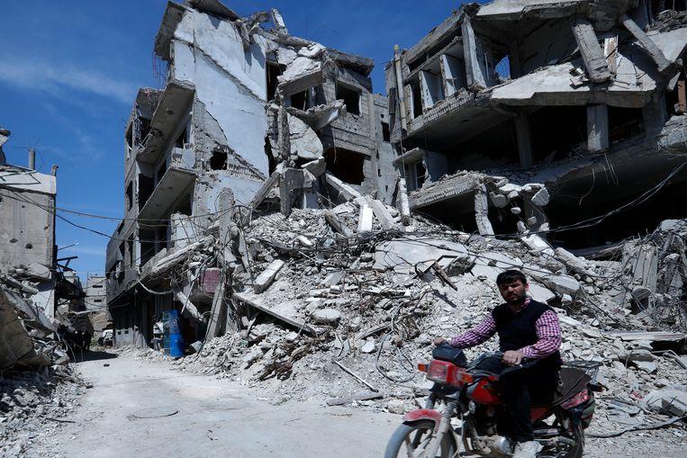 De stad Douma, nabij Damascus, waar de Syrische regering begin deze maand een aanval met gifgas zou hebben uitgevoerd.