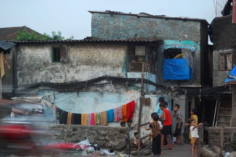 Geen modecollectie, wel kleurrijke kleding in Dharavi, Mumbai's grootste sloppenwijk.  Beeld RV