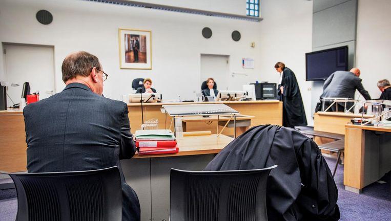 Joris Demmink in het beklaagdenbankje in november 2014. Beeld Raymond Rutting / de Volkskrant