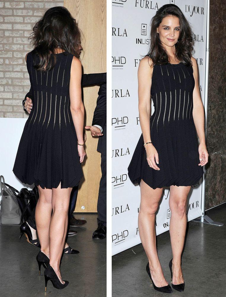 Katie Holmes op een feestje van Dujour Magazine in 2014. Ze draagt een jurk van Azzedine Alaïa.