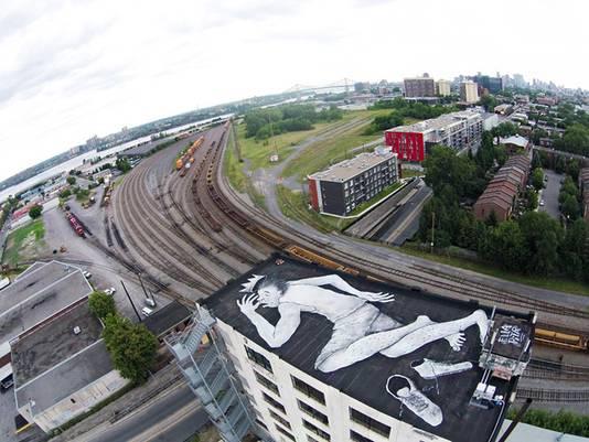 Dakschildering van Ella & Pitr in het Canadese Montréal.
