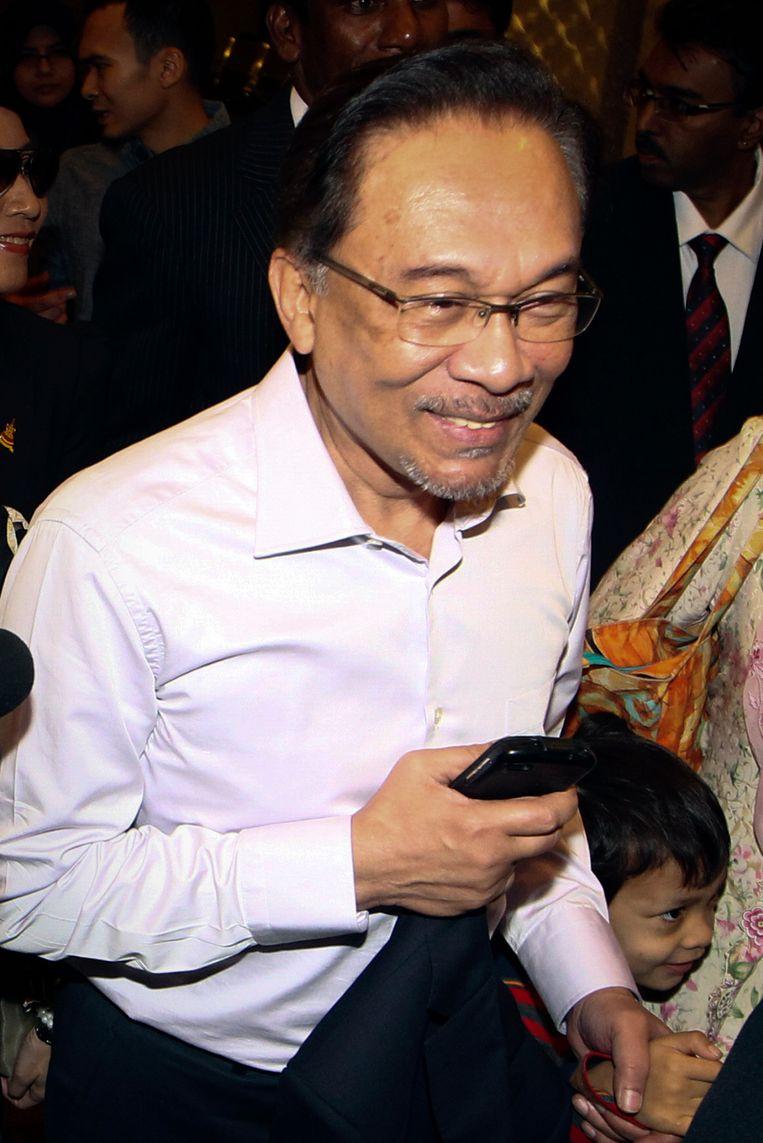 De Maleisische oppositieleider Anwar Ibrahim op weg naar het gerechtsgebouw op 10 februari dit jaar. Beeld AP
