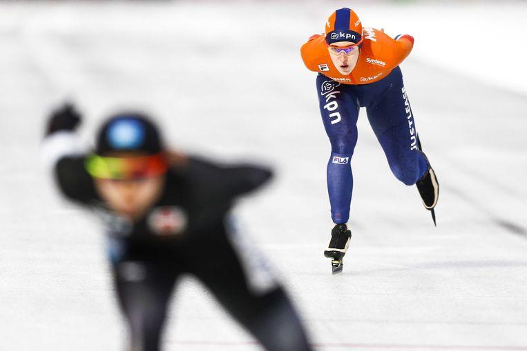 Ireen Wust in actie op de 1500 meter tegen Miho Takagi uit Japan op het WK Allround Schaatsen  in het Olympisch Stadion.  Beeld ANP