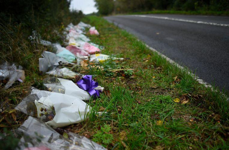 Bloemen bij de plek van het ongeluk. Beeld Getty Images