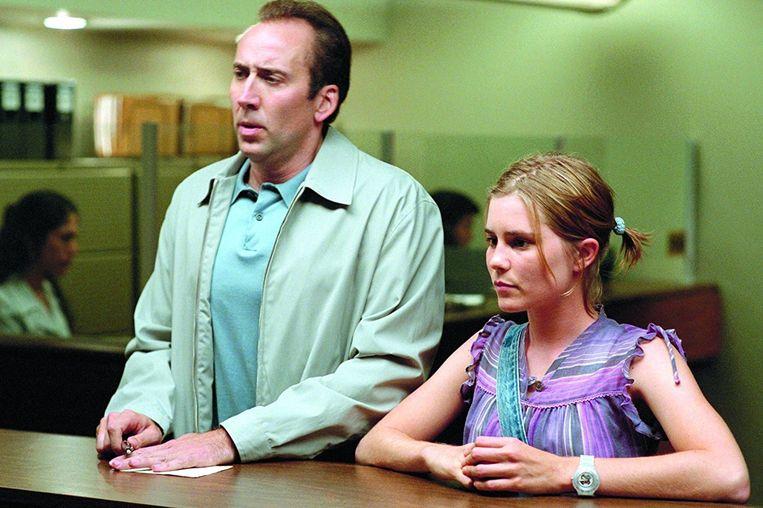 Nicholas Cage en Alison Lohman in Matchstick Men. Beeld geen