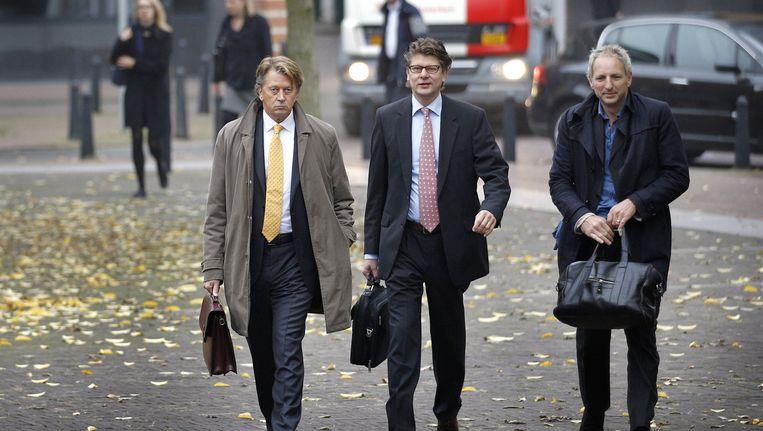 De broers Poot en advocaat Matthijs Kaaks. Beeld anp