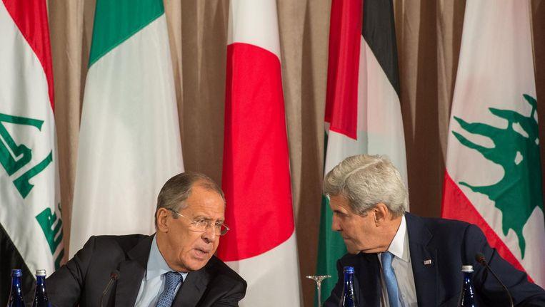 De Russische en Amerikaanse ministers van Buitenlandse Zaken, Sergej Lavrov en John Kerry. Het kille klimaat van de Koude Oorlog is terug, schrijft Bert Lanting. Beeld afp