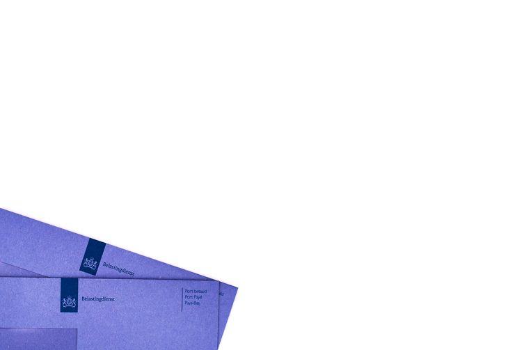Blauwe enveloppen in de printstraat van de Belastingdienst.  Beeld anp