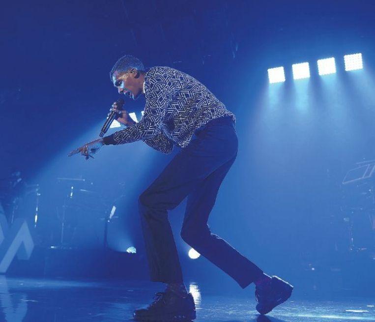 Stromae op het podium in Palais 12 in Brussel, afgelopen donderdag. Beeld afp