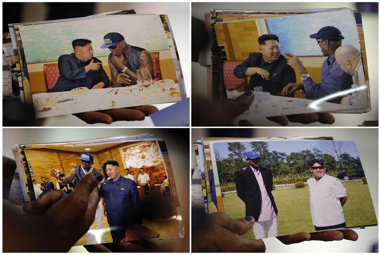Foto's die Dennis Rodman zaterdag bij terugkomst uit Noord-Korea liet zien aan de media. Beeld reuters