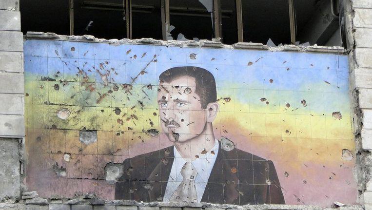 Een afbeelding van de Syrische president Bashar al-Assad op een gebouw in Aleppo. Beeld reuters
