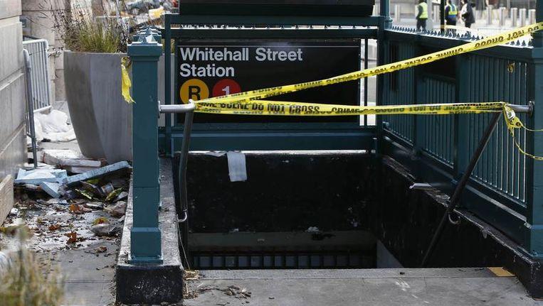 Een afgesloten metro-ingang in Manhattan. Beeld reuters