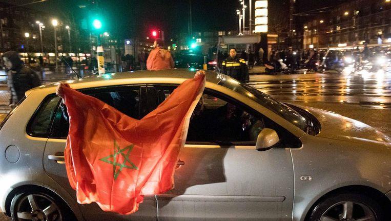 Fans van het Marokkaanse voetbalelftal vierden feest op het Mercatorplein, nadat Marokko zich plaatste voor het WK. Beeld ANP